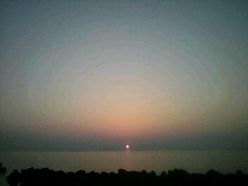 『魚津港の夕日』